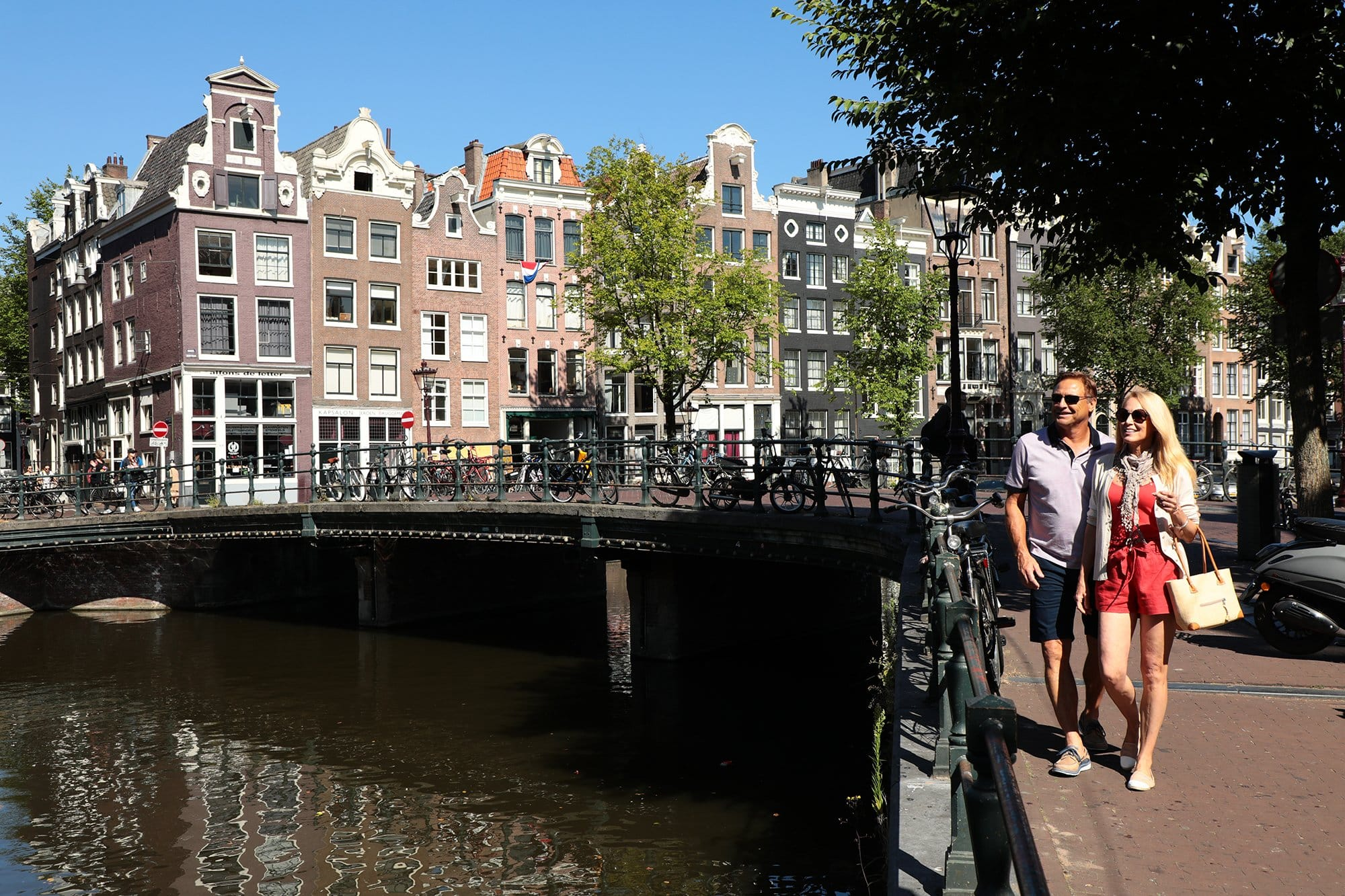 Couple Walking Amsterdam Canals
